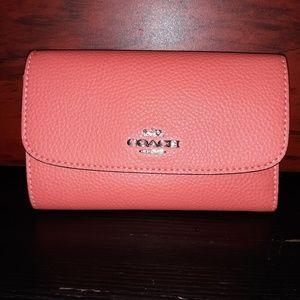 Pink Coach bifold wallet